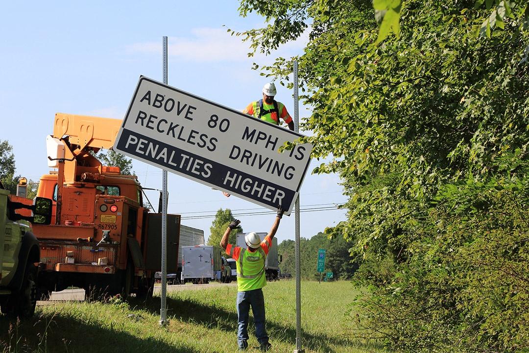 reckless-driving-sign-installation.jpeg