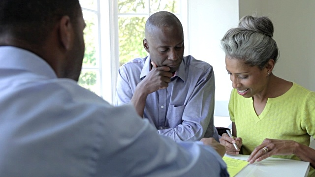 mature-black-couple-meeting-with-financial-advisor-at-home-video-id467170940